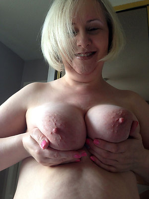 Busty older wife showing nipples photo