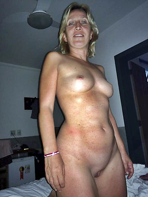 Slutty mature wife with small tits