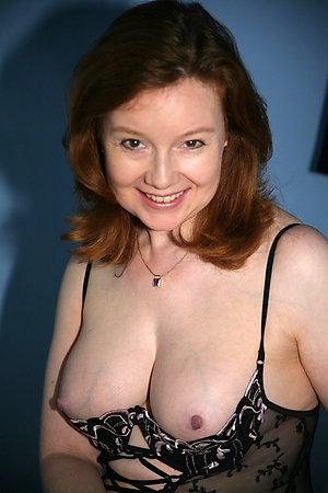 Undressed sexy redhead slut amateur pics