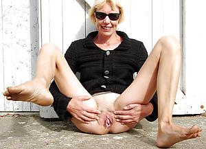 Titillating hairy mature vagina