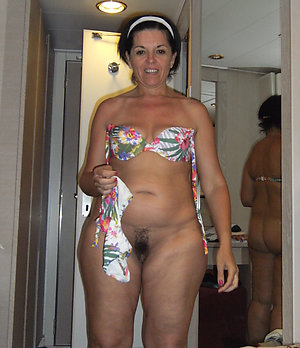 Cute sexy mature woman in bikinis