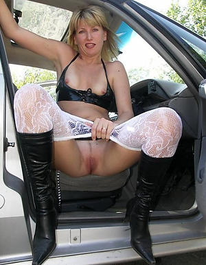 Busty nude mature in motor car