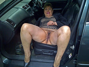 Naughty mature in automobile undisguised pics