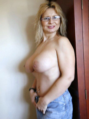 Naughty horny mature with glasses