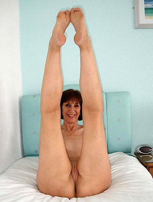 Pretty mature women spreading legs photo